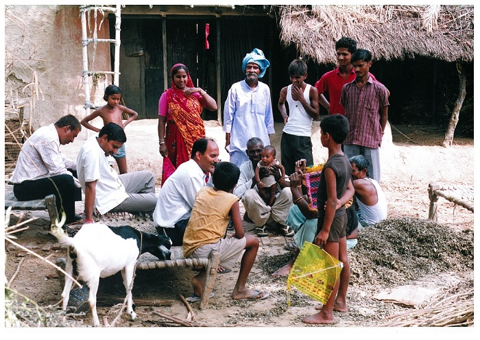 In this photo, everyone, including the baby, appears to be paying attention to the person sitting in the center. Rakesh took this photo in 2007 when he visited his village in India where he spent first two years of his life. This was his first visit to the village in nearly 50 years.